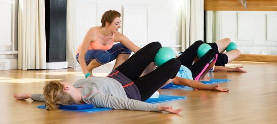 Jyoti demonstrating pilates