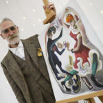 John Byrne beside his artwork.